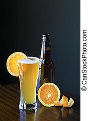 Belgium Wheat Ale With Orange Slice - A glass of Belgium...