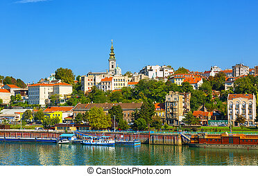 Belgrade from river Sava with tourist riverboats on a sunny day, Serbia