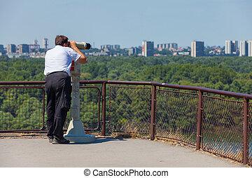 Tourist using binoculars