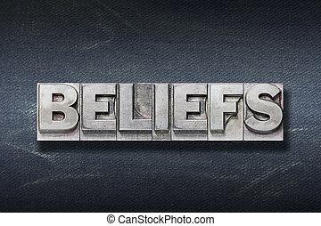beliefs word made from metallic letterpress on dark jeans background