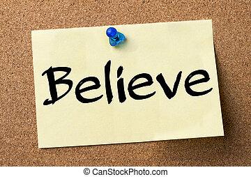 Believe - adhesive label pinned on bulletin board -...