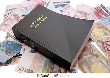 the king james version bible with money showing believe and receive
