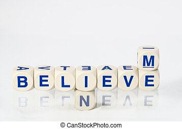 Believe in me spelled out in letter dice