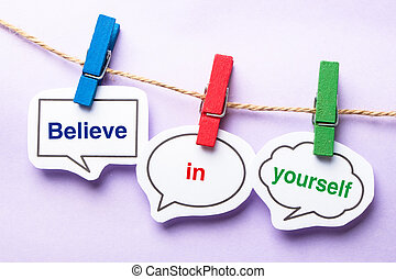 Believe in yourself paper bubbles with clip hanging on the...