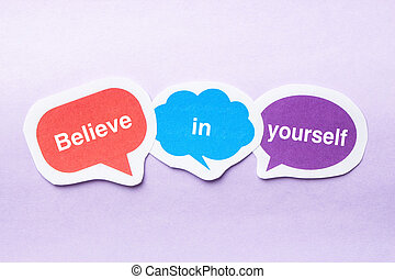 Believe in yourself concept paper bubbles against purple...