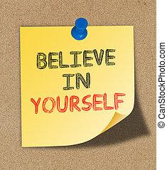 Believe In Yourself written on yellow note pinned on cork board