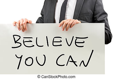 Believe you can - Personal motivator holding white board...