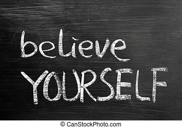 Believe yourself text written on blackboard
