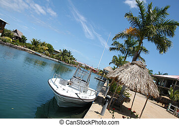 Belize, Placencia - Boat on coast of peninsula Placencia