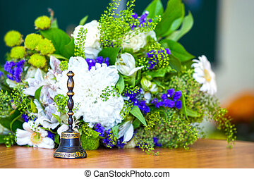 Bell. Bouquet on September 1. Classroom. The beginning of the school year. School board in the background.