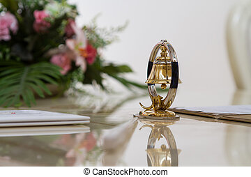Bell decoration on the glossy table