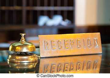 bell in hotel reception - Golden bell on reception desk in...