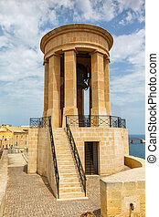 Bell of Peace in Malta, bell tower against bright blue sky....