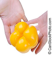 Bell pepper in a hand isolated on the white background