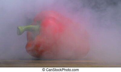 bell pepper or capsicum is on the table and smoke or steam...