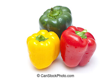 Bell peppers (green, yellow and red) isolated on white background