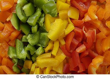 Red, Yellow, Orange & Green bell peppers, chopped up, ready for cooking