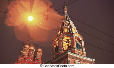 Bell-ringer at belfry of the old Russian church