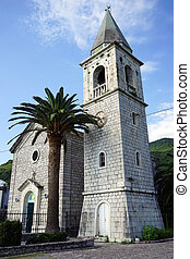 Bell tower and small stone church in Tivat, Montenegro