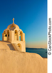 Bell tower in Santorini island at sunset