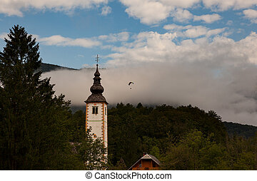 Bell tower of St John the Baptist church in Bohinj