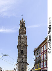 Bell tower of the Clerigos Church in blue sky background, is...