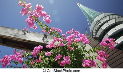 Bell Tower with flowers - Bottom view of flowers and...