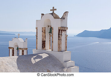 bell towers on church in Oia