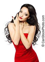 bella donna, ritratto, con, labbra rossi, lungo, riccio, capelli, in, vestito rosso, sopra, sfondo bianco