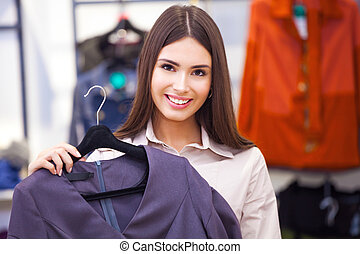 belle femme, achats, quelques-uns, regarder, clothing.
