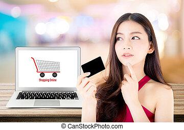 belle femme, achats, utilisation, pensée, sommet, asie, labtop, crédit, bokeh, cahier, computer., ligne, table, girl, paiement, carte, fond