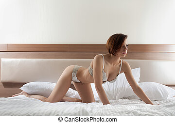 belle femme, dans, lingerie, lit