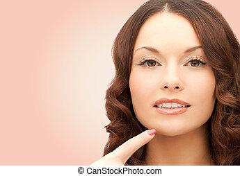 belle femme, elle, pointage, jeune, menton, doigt