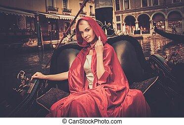 belle femme, gondole, manteau, équitation, rouges