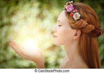 belle femme, naturel, arrière-plan vert, mains, fée, lueur