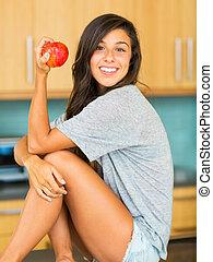belle femme, pomme, jeune, tenue, rouges