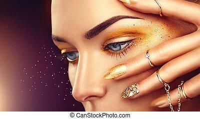 belleza, moda, mujer, con, dorado, maquillaje, oro, accesorios, y, clavos