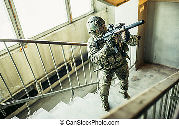 belligerent soldier in landing - warlike soldier man goes up...