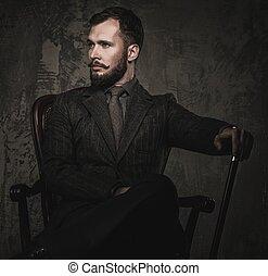 bello, bene-vestito, con, bastone, seduta, in, sedia cuoio