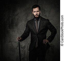 bello, bene-vestito, uomo, con, bastone da passeggio