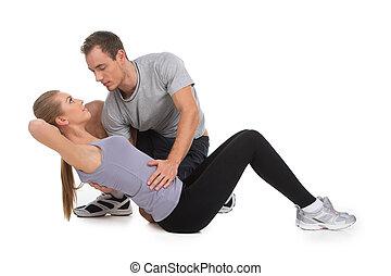 bello, donna, esercitarsi, con, lei, personale, trainer., isolato, bianco