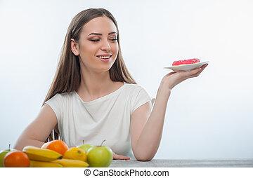 bello, giovane ragazza, è, guardando, cibo dolce