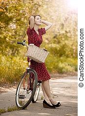 bello, ragazza, con, bicicletta, a, countryside., vintage.