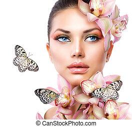 bello, ragazza, con, orchidea, fiori, e, farfalla