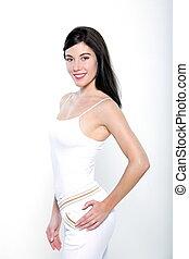 bello, standing, donna, ritratti, allenamento, giovane, isolato, studio, fondo, bianco, abbigliamento sportivo