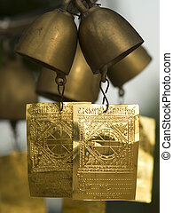 Bells at a Buddhist temple - Small brass bells at a Buddhist...