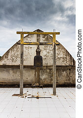 bells of temple in thailand located near white wall