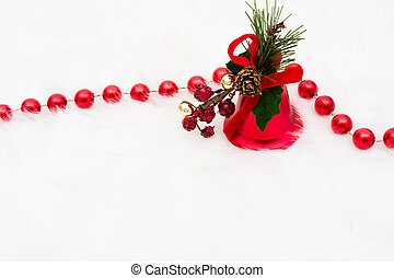 Bells - Pine needles and pine cone with bells on a white...