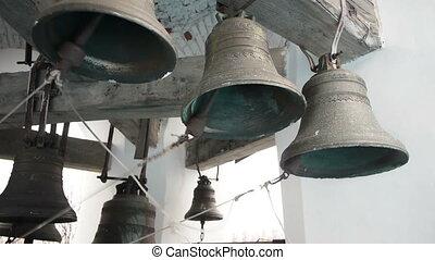 Bells striking by bell ringer in monastery
