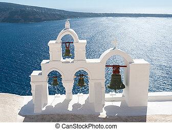 Bells tower over the beautiful sea of Santorini